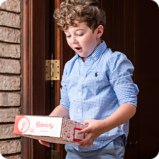 Boy holding Baketivity box