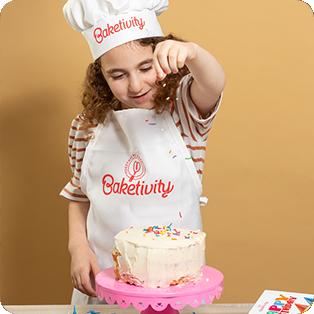 Girl baking birthday cake